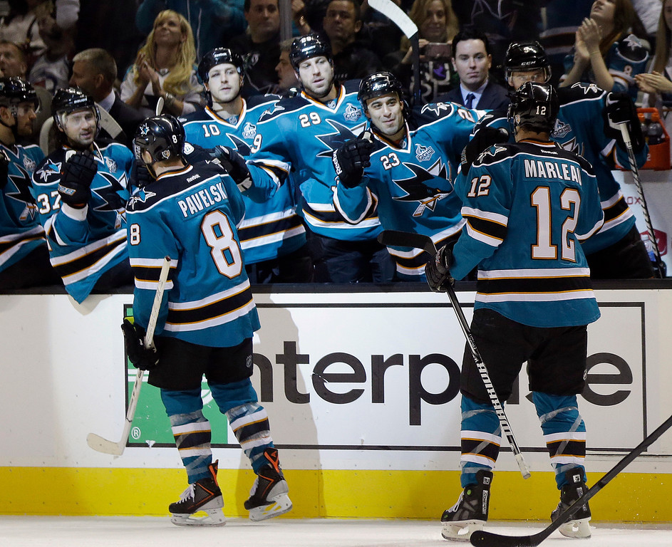 . San Jose Sharks center Patrick Marleau (12) is high-fived by teammates after his second goal of the first period of an NHL hockey game against the Colorado Avalanche in San Jose, Calif., Saturday, Jan. 26, 2013. (AP Photo/Marcio Jose Sanchez)