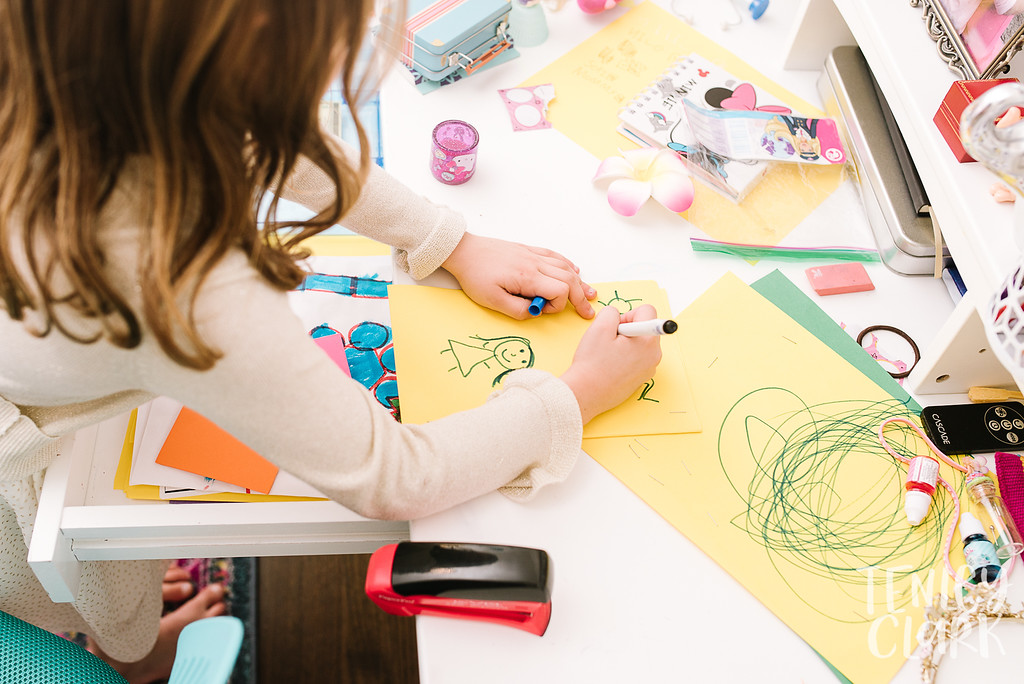 Little girl drawing at desk. Lifestyle in-home family photoshoot in Marin, CA by Tenley Clark Photography.