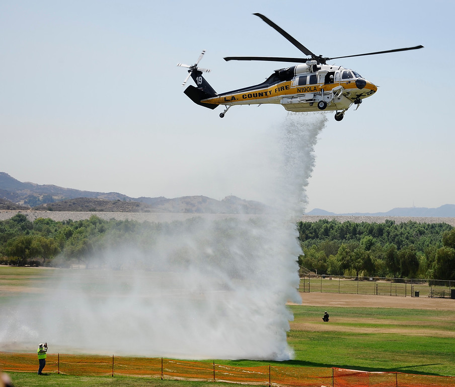 . LA county fire hawk makes a water drop during the 20th anniversary of American Heroes Air Show Courage at the Speed of Flight at Hansen Dam. Lake View Terrace CA.  June 29,2013. Photo by Gene Blevins/LA Daily News