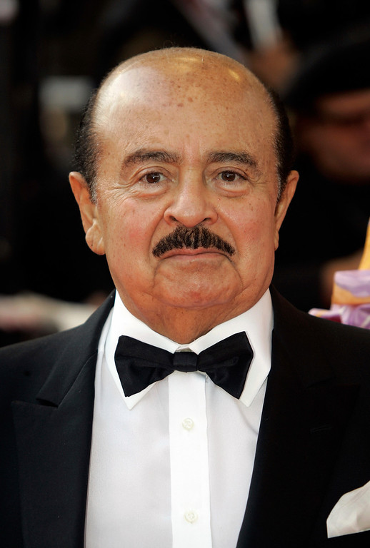 """. FILE - In this Wednesday, May 14, 2008 file photo, Adnan Khashoggi arrives at the opening night ceremony and premiere of the film \""""Blindness\"""" during the 61st International film festival in Cannes, southern France. Saudi arms dealer Khashoggi, once one of the world\'s richest men who was implicated in the Iran-Contra affair, has died. He was 81 and had been suffering from Parkinson\'s disease, it was reported on Tuesday, June 6, 2017.  (AP Photo/Lionel Cironneau, File)"""
