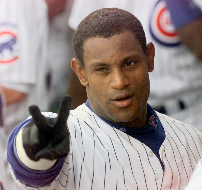 . SAMMY SOSA -- Chicago Cubs slugger Sammy Sosa flashes a victory sign as he steps into the dugout after hitting his 62nd home run of the season in Chicago on Sept. 13, 1998. The run made Sosa tied with Mark McGwire in the race to set a new single-season home run record. (AP Photo/Beth A. Keiser)