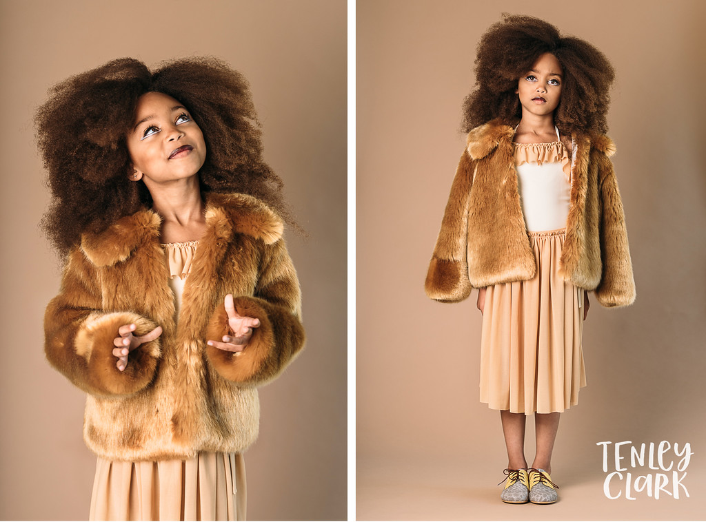 Playful studio kids fashion editorial with kids mimicking animals and double exposures featured on Babiekins Magazine blog by Tenley Clark Photography. Styling: Jeneffer Jones. HMUA: Amy Lawson. Model: Vivi. Lion look.