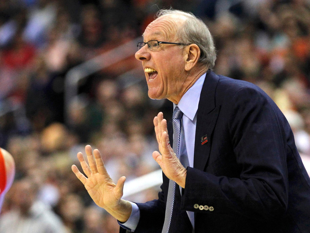 . Syracuse Orange head coach Jim Boeheim yells to his team playing the Marquette Golden Eagles in their East Regional NCAA men\'s basketball game in Washington, March 30, 2013. REUTERS/Jason Reed