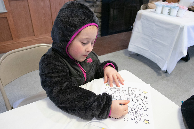 Coloring Saturday, Feb. 1, 2020 at Winterfest held at Coggshall Park in Fitchburg is Madelyn Couture, 5, from Fitchburg. SENTINEL & ENTERPRISE/JOHN LOVE