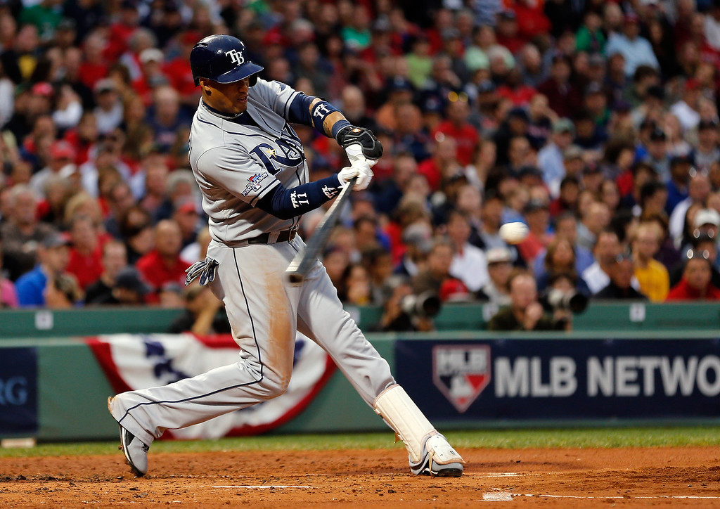 . BOSTON, MA - OCTOBER 05: Yunel Escobar #11 of the Tampa Bay Rays hits against the Boston Red Sox during Game Two of the American League Division Series at Fenway Park on October 5, 2013 in Boston, Massachusetts.  (Photo by Jim Rogash/Getty Images)