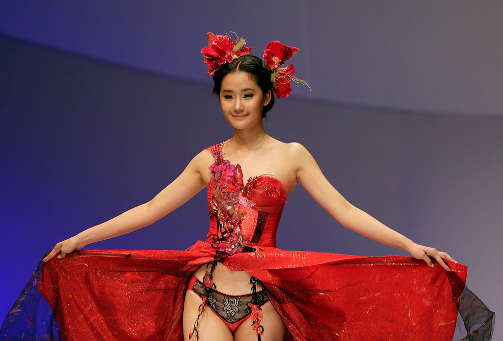 . A model on stage presents a creation for Ordifen Cup China Lingerie Design Contest during China Fashion Week in Beijing, China Wednesday, Oct. 29, 2014. (AP Photo/Andy Wong)