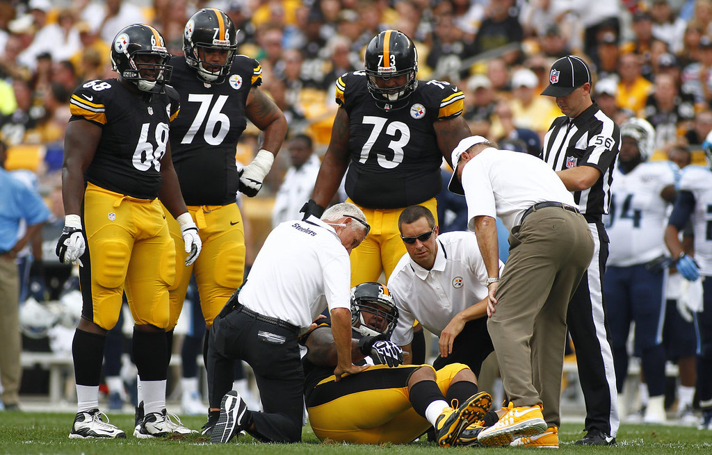 . Maurkice Pouncey #53 of the Pittsburgh Steelers is tended to by medical staff in the first half during the game against the Tennessee Titans on September 8, 2013 at Heinz Field in Pittsburgh, Pennsylvania.  (Photo by Justin K. Aller/Getty Images)