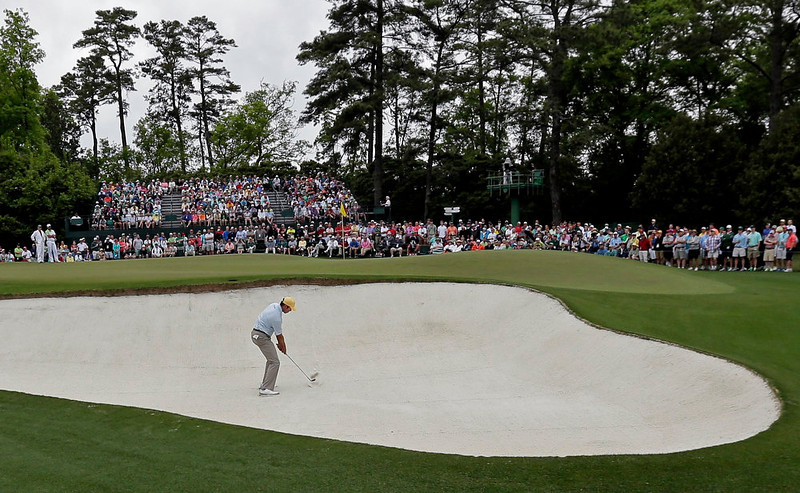 . Matt Kuchar hits out of a bunker on the first hole during the fourth round of the Masters golf tournament Sunday, April 14, 2013, in Augusta, Ga. (AP Photo/Charlie Riedel)