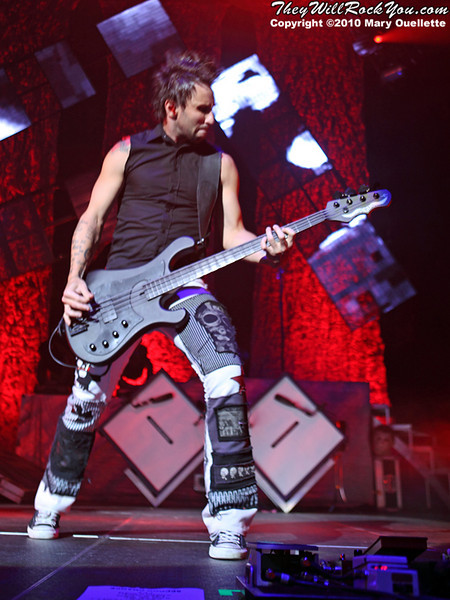"""Eric Bass of Shinedown performs on the """"Carnival of Madness"""" tour at the Mohegan Sun Arena on August 4, 2010 in Uncasville, Connecticut."""