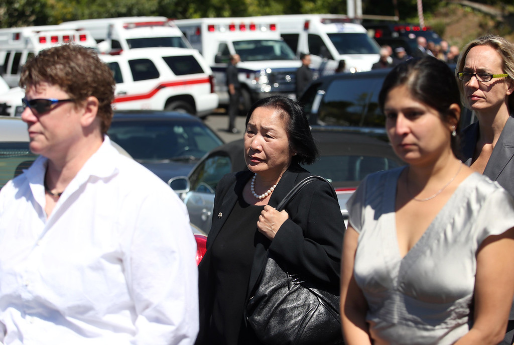 . Oakland Mayor Jean Quan, center, attends funeral services for Santa Clara paramedic Quinn Boyer, 34, of Dublin, at St. Theresa Catholic Church in Oakland, Calif., on Tuesday, April 16, 2013. Boyer was shot and killed while driving his car on Keller Avenue and Hansom Drive on April 2. Police have not arrested anyone in connection with the case.  (Jane Tyska/Staff)