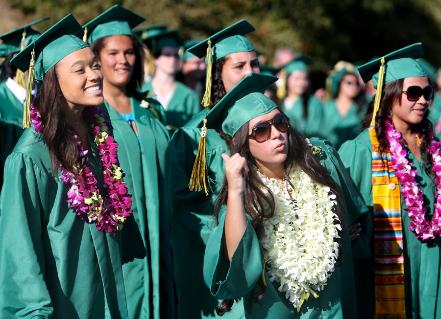 . Harbor High graduating seniors pose for pictures and celebrate with their friends during the graduation ceremony at Cabrillo College in Aptos on Friday. (Kevin Johnson/Sentinel)