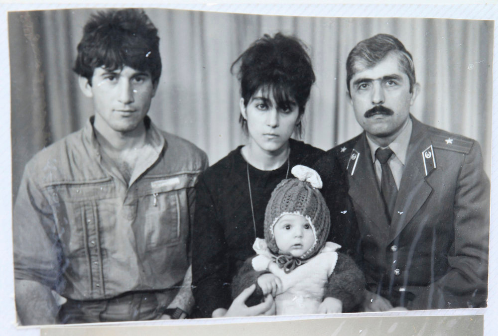 . A photo, showing Tamerlan (C, bottom) Tsarnaev, accompanied by his father Anzor (L), mother Zubeidat and uncle Muhamad Suleimanov (R), is seen in this photo courtesy of the Suleimanova family in Makhachkala, April 22, 2013.   REUTERS/Courtesy of Suleimanova family/Handout