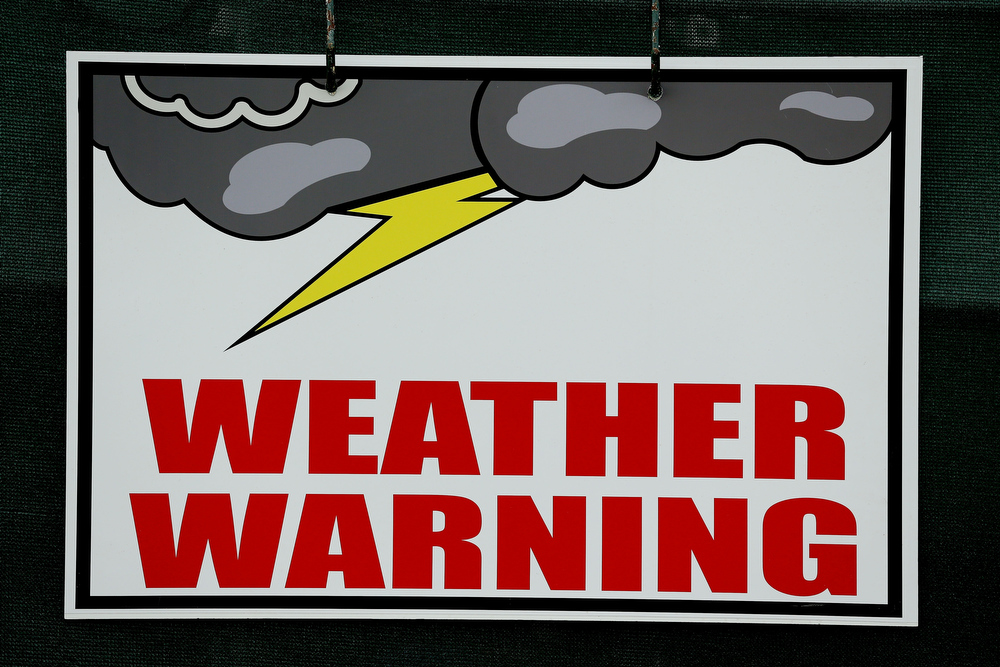 . A weather warning sign is seen during Round One of the 113th U.S. Open at Merion Golf Club on June 13, 2013 in Ardmore, Pennsylvania.  (Photo by Andrew Redington/Getty Images)