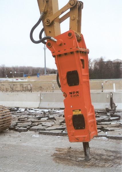 NPK E208 hydraulic hammer on Cat excavator - road construction at 83 & I-71 in Strongsville 12-15-00 (15).jpg