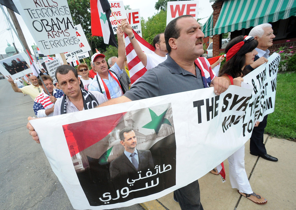 . Members of the Syrian community today protested U.S. or NATO involvement in Syria\'s unrest Friday, Aug. 30, 2013, in Allentown, Pa. (AP Photo/ Express-Times, Sue Beyer)
