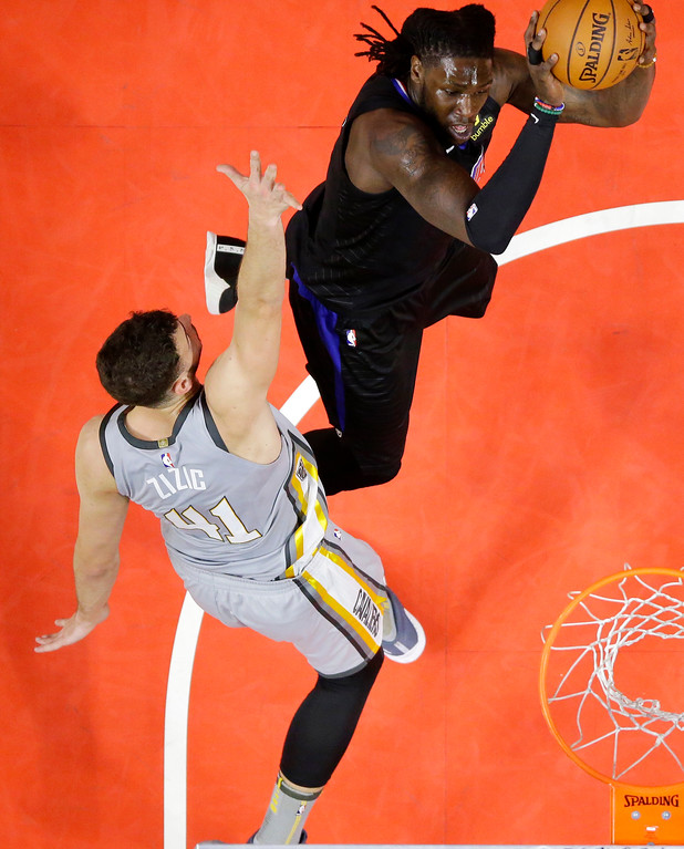 . Los Angeles Clippers forward Montrezl Harrell, right, shoots as Cleveland Cavaliers forward Ante Zizic, of Croatia, defends during the first half of an NBA basketball game, Friday, March 9, 2018, in Los Angeles. (AP Photo/Mark J. Terrill)