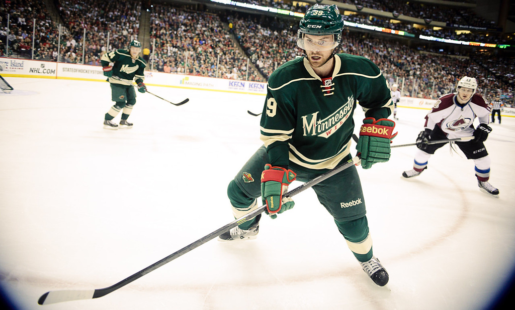. Wild defenseman Nate Prosser looks for the puck in corner against the Avs during the first period.  (Pioneer Press: Ben Garvin)