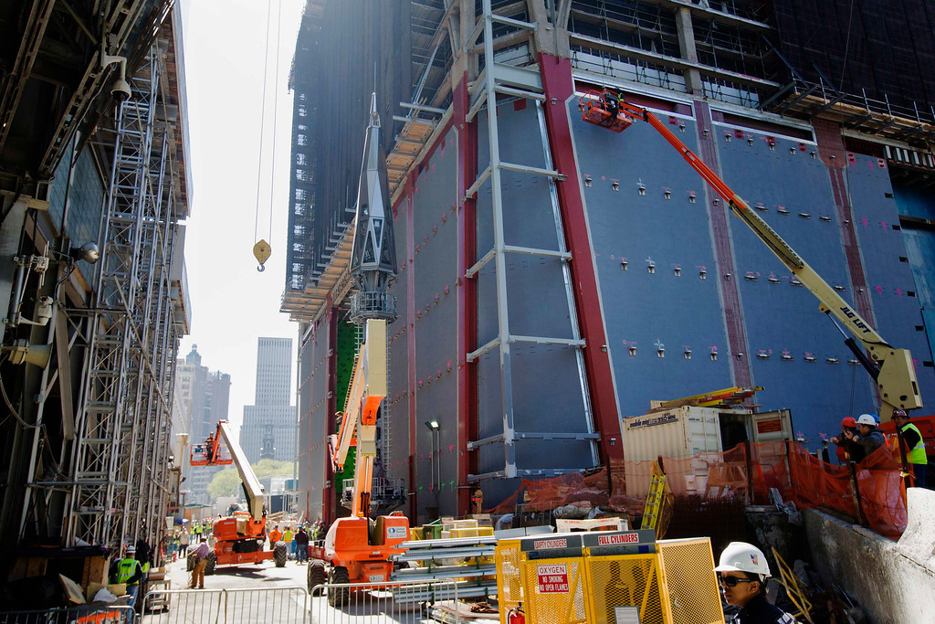 . The final piece of One World Trade Center\'s spire is seen next to the base of the building before it is lifted to the top in New York, May 2, 2013. REUTERS/Lucas Jackson