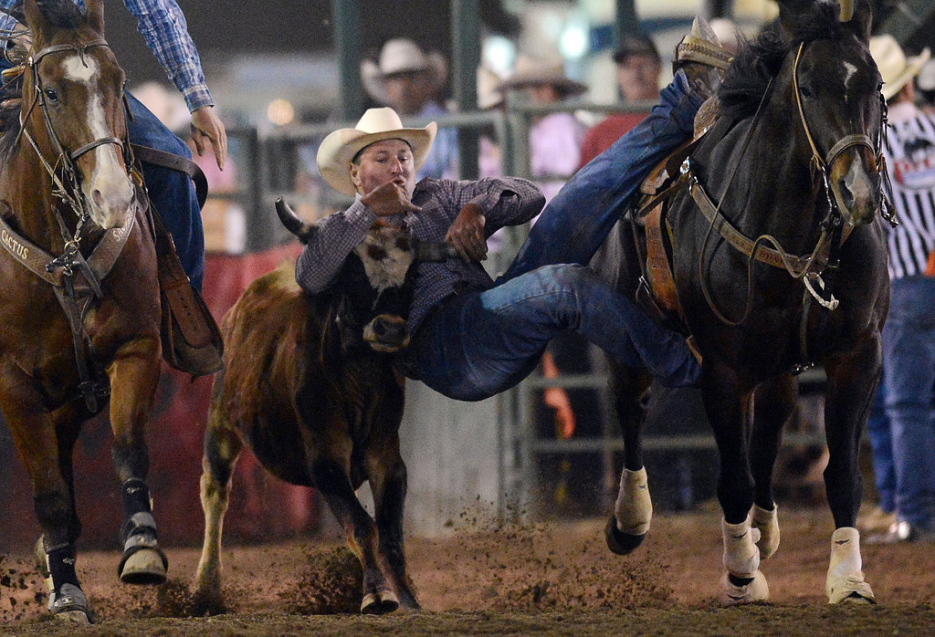 . Action from the 14th annual P.R.C.A. San Bernardino County Sheriff\'s Rodeo in Devore, Calif. Saturday evening September 28, 2013.  (Will Lester/Inland Valley Daily Bulletin)
