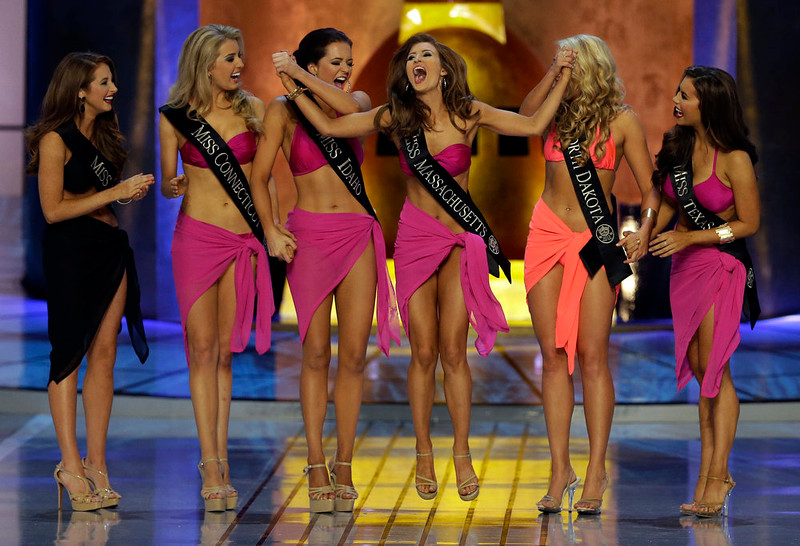 . Miss Massachusetts Lauren Kuhn celebrates after moving on to the evening gown portion of the Miss America 2015 pageant, Sunday, Sept. 14, 2014, in Atlantic City, N.J. (AP Photo/Mel Evans)