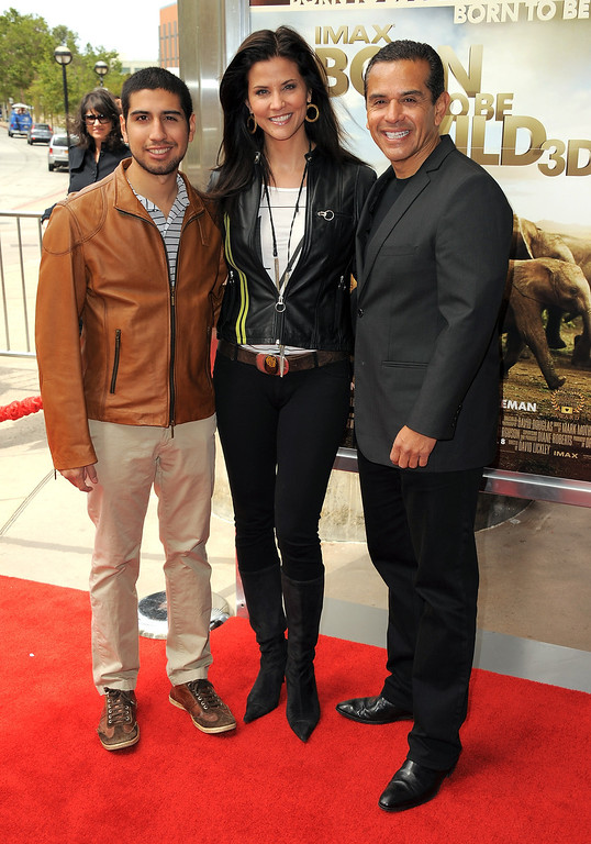 ". Lu Parker and Los Angeles Mayor Antonio Villaraigosa with his son Antonio Villaraigosa Jr. arrive at the ""Born To Be Wild 3D\"" Los Angeles Premiere at California Science Center on April 3, 2011 in Los Angeles, California.  (Photo by Jordan Strauss/Invision/AP Images)"