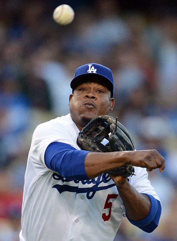 . The Dodgers\' Juan Uribe #5 throws to 1st for the out during game against the Red Sox at Dodger Stadium Friday, August 23, 2013 in Los Angeles. The Dodgers beat the REd Sox 2-0. (Hans Gutknecht/Los Angeles Daily News)