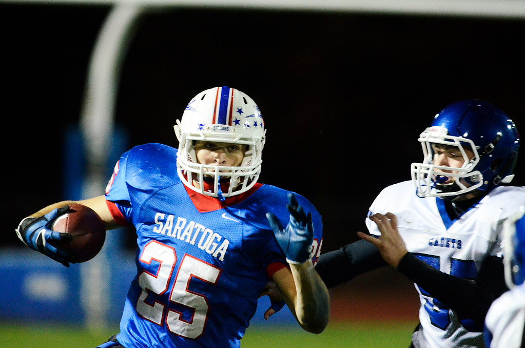 . Erica Miller - The Saratogian @togianphotog      Saratoga\'s Dakota Harvey runs down the field during their playoff football game against LaSalle on Friday evening under the lights in Saratoga. SAR-l-SarFootball7