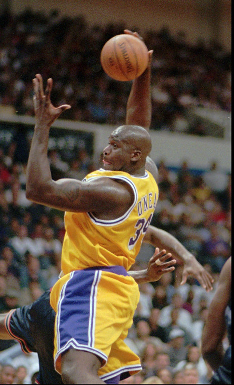 . Los Angeles Lakers\' Shaquille O\'Neal hauls in a rebound during the first quarter of the Lakers\' opening game of the exhibition season against the Denver Nuggets Thursday Oct.9, 1997 in San Diego. (AP Photo/Mike Poche)