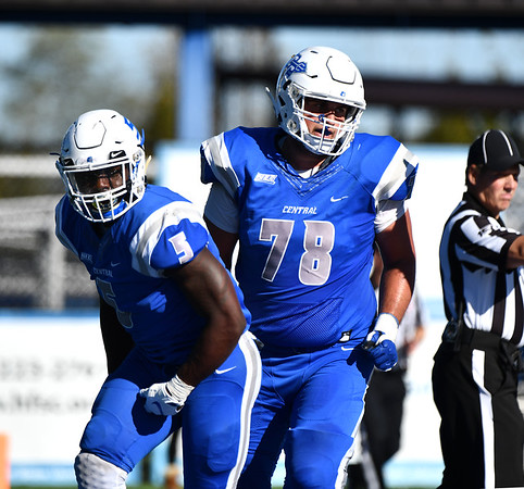 10/19/2019 Mike Orazzi | StaffrCentral Connecticut State University 's Danley Exilhomme (5) and Jake Schena (78) celebrate during Saturday's football game with Bryant in New Britain.