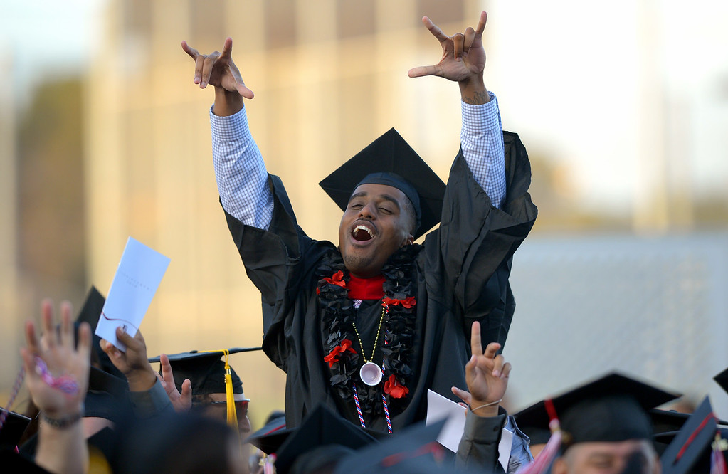 . Long Beach City College\'s class of 2014 celebrates prior to receiving their certificates and degrees at Veterans Memorial Stadium in Long Beach, CA on Thursday, June 5, 2014. (Photo by Scott Varley, Daily Breeze)