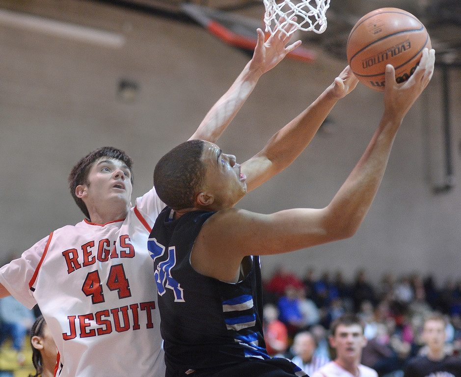 . Ranch center Zach Braxton (34) worked his way past Regis defender Kip Boryla (44) in the second half. The Regis Jesuit High School boy\'s basketball team defeated Highlands Ranch 63-54 Tuesday night, February 4, 2014. Photo By Karl Gehring/The Denver Post