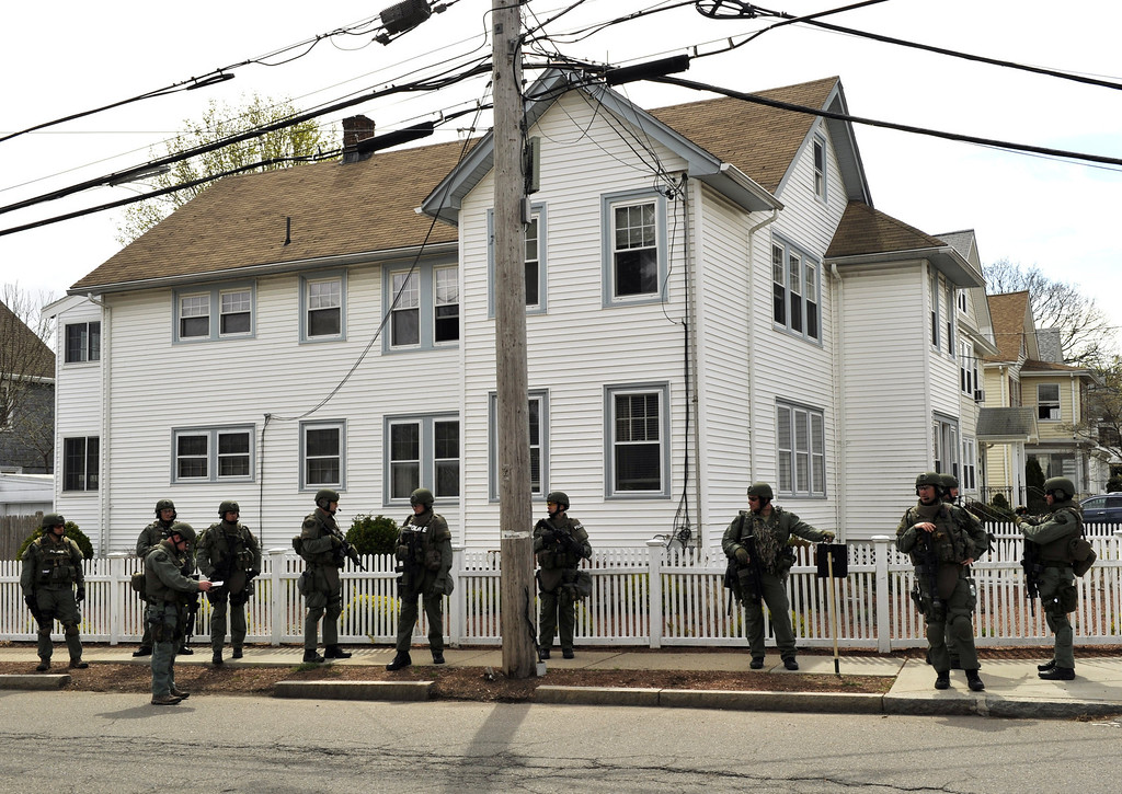 . The Cape Cod  Police Department SWAT team search houses for the second of two suspects wanted in the Boston Marathon bombings takes place April 19, 2013 in Watertown, Massachusetts. AFP PHOTO / TIMOTHY  A. CLARY/AFP/Getty Images