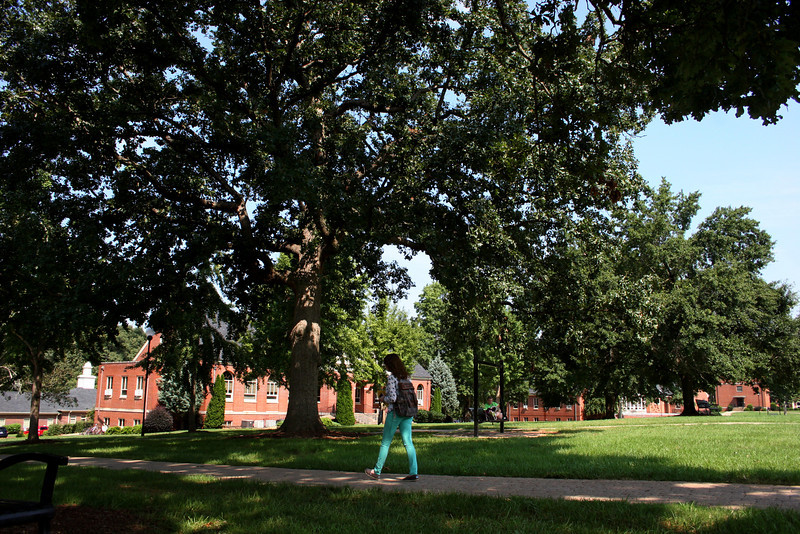 A Gardner-Webb student walks across campus to class.