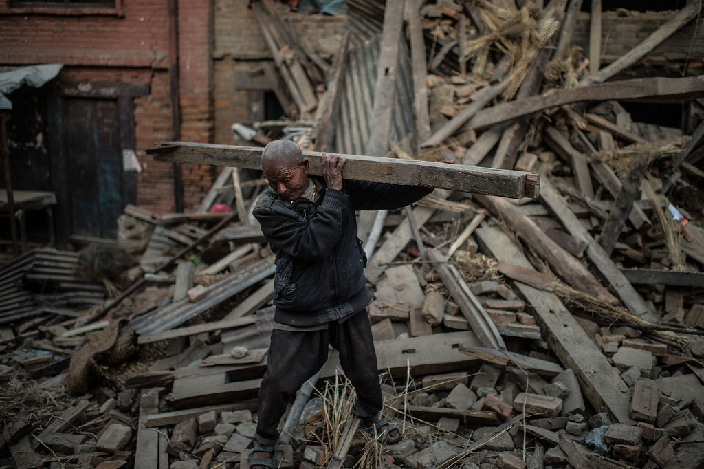 . A Nepalese earthquake victim removes debris from his home on April 29, 2015 in Bhaktapur, Nepal. A major 7.8 earthquake hit Kathmandu mid-day on Saturday, and was followed by multiple aftershocks that triggered avalanches on Mt. Everest that buried mountain climbers in their base camps. Many houses, buildings and temples in the capital were destroyed during the earthquake, leaving over 5000 dead and many more trapped under the debris, as emergency rescue workers attempt to clear debris and find survivors. Regular aftershocks have hampered recovery missions as locals, officials and aid workers attempt to recover bodies from the rubble.  (Photo by David Ramos/Getty Images)