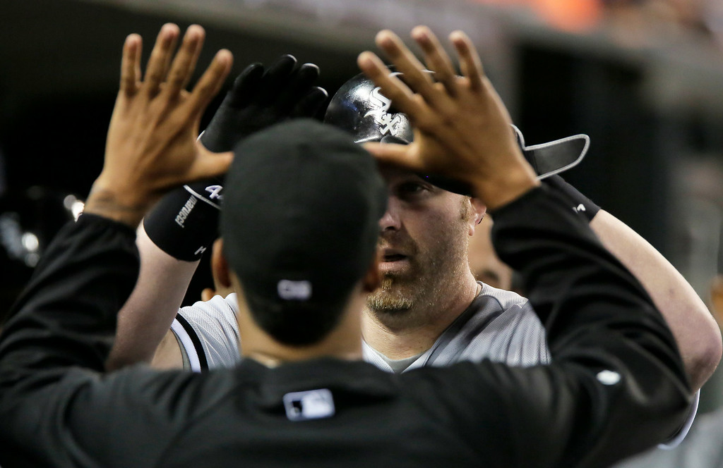. Chicago White Sox\'s Adam Dunn is congratulated after hitting a solo home run against the Detroit Tigers during the seventh inning of a baseball game Tuesday, July 29, 2014, in Detroit. The White Sox defeated the Tigers 11-4. (AP Photo/Duane Burleson)