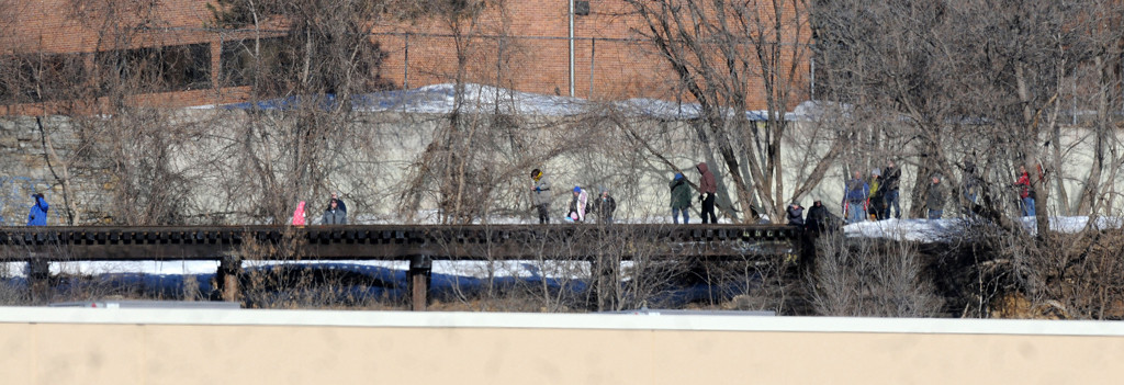 . Spectators watch the demo from train tracks near the Island Station coal power plant at 380 Randolph Avenue in St. Paul on Sunday morning, March 16, 2014.  (Pioneer Press: Sherri LaRose-Chiglo)