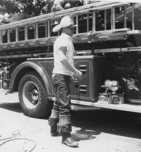 Carlton Thomas  (checking truck)