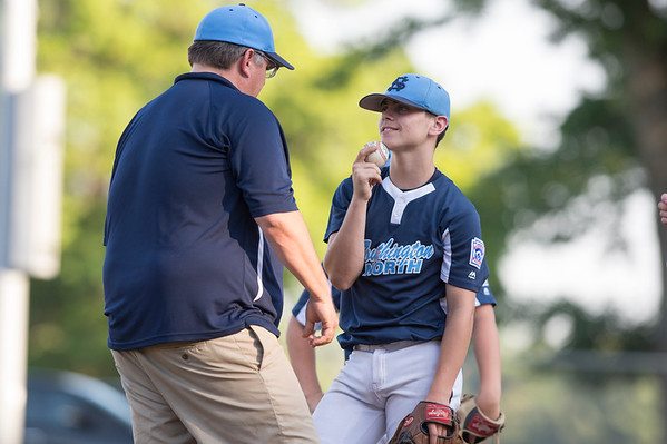 07/08/19 Wesley Bunnell | Staff Forrestville vs Southington North Little League baseball at Recreation Park in Southington on Monday July 8, 2019. Pitcher Aiden Halpin (8) during a mound visit.