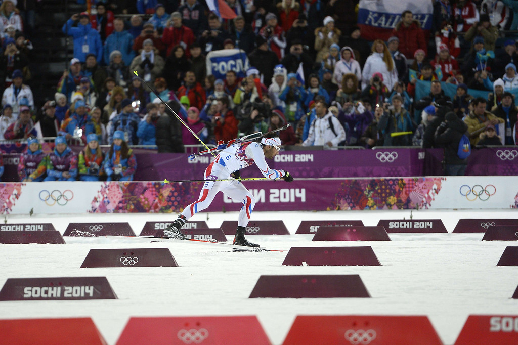 . Gold medalist France\'s Martin Fourcade skis in the finish area to win the Men\'s Biathlon 12,5 km Pursuit at the Laura Cross-Country Ski and Biathlon Center during the Sochi Winter Olympics on February 10, 2014 in Rosa Khutor near Sochi.  PIERRE-PHILIPPE MARCOU/AFP/Getty Images