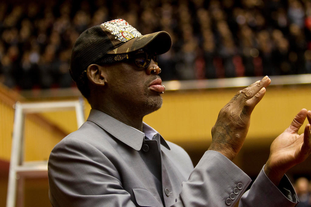 . Dennis Rodman applauds from court side at an exhibition basketball game between U.S. and North Korean players at an indoor stadium in Pyongyang, North Korea on Wednesday, Jan. 8, 2014. (AP Photo/Kim Kwang Hyon)
