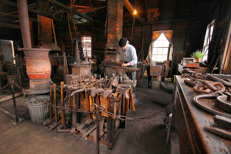 The blacksmith demonstrated the old techniques for bending metal into a variety of shapes and devices used in Colonial days.