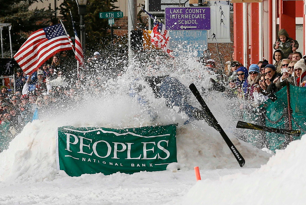 . A skier crashes headfirst into a jump during the annual skijoring competition in downtown Leadville, Colorado March 2, 2013. This was the 62nd year for the competition in Leadville.  REUTERS/Rick Wilking
