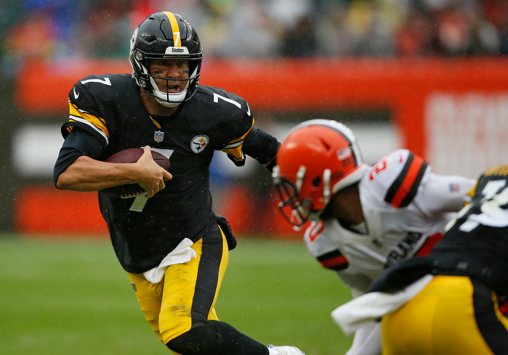 . Pittsburgh Steelers quarterback Ben Roethlisberger avoids a tackle during the first half of an NFL football gameagainst the Cleveland Browns, Sunday, Sept. 9, 2018, in Cleveland. (AP Photo/Ron Schwane)