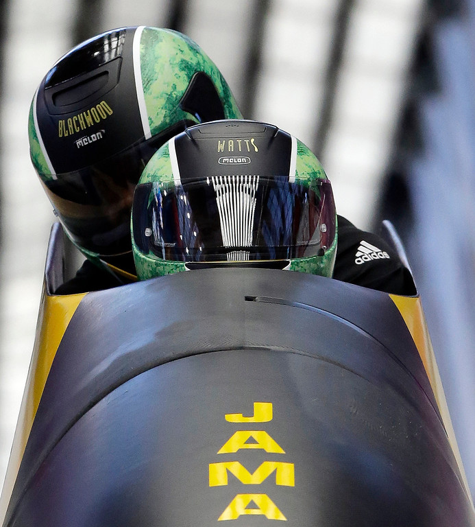 . The two-man team from Jamaica JAM-1, piloted by Winston Watts, brake in the finish area during the men\'s two-man bobsled training at the 2014 Winter Olympics, Thursday, Feb. 13, 2014, in Krasnaya Polyana, Russia. (AP Photo/Dita Alangkara)