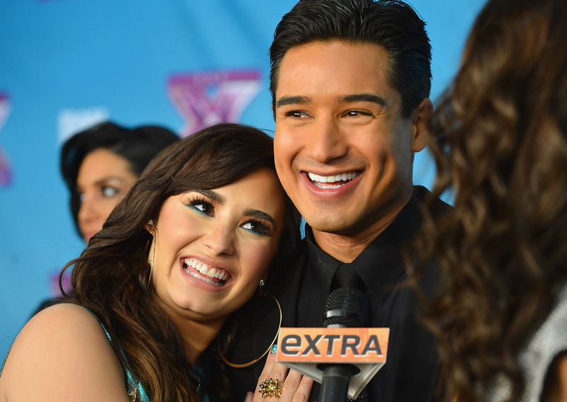 ". Singer Demi Lovata and Mario Lopoz at Fox\'s ""The X Factor\"" Season Finale - Night 2 at CBS Televison City on December 20, 2012 in Los Angeles, California.  (Photo by Frazer Harrison/Getty Images)"