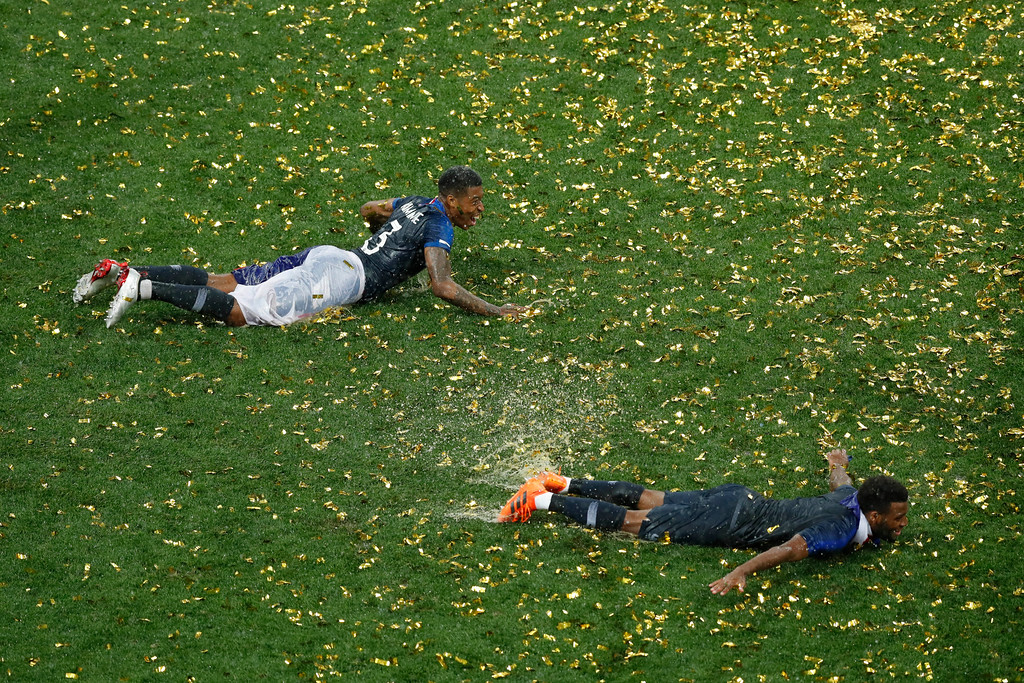 . France players celebrate at the end of the final match between France and Croatia at the 2018 soccer World Cup in the Luzhniki Stadium in Moscow, Russia, Sunday, July 15, 2018. (AP Photo/Rebecca Blackwell)