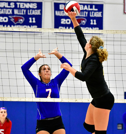 9/27/2018 Mike Orazzi | Staff St. Paul Volleyball's Rebecca Nerbonne (7) and Woodland's Lexie Chabot (25)