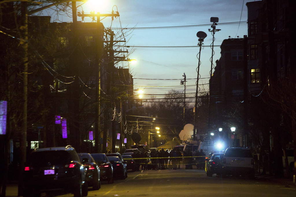 . Members of the media converge in front of an apartment at 1313 Grand Street, believed to be connected to the Connecticut elementary school shooting, on December 14, 2012 in Hoboken, New Jersey.  According to reports, there are 27 dead, including 20 children, after a gunman opened fire in at the Sandy Hook Elementary School in Newtown, Connecticut. The shooter, identified as Adam Lanza, was also found dead at the scene.  (Photo by Michael Nagle/Getty Images)