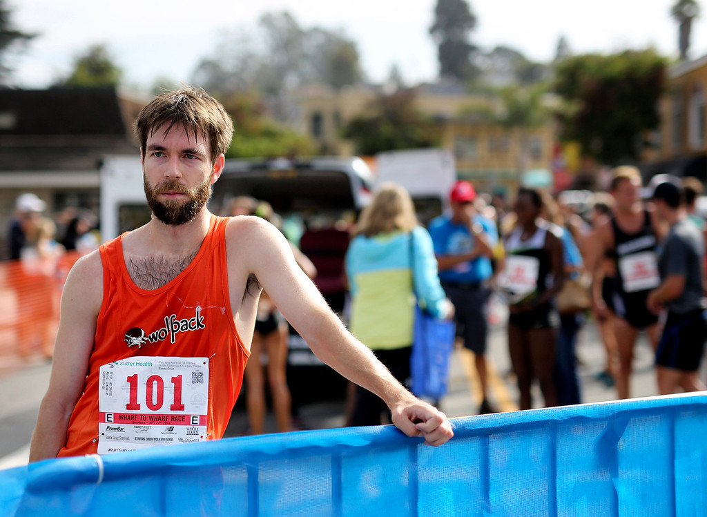 . A runner stands at the finish area in Capitola Village on Sunday after he completed the Wharf to Wharf race. (Kevin Johnson -- Santa Cruz Sentinel)