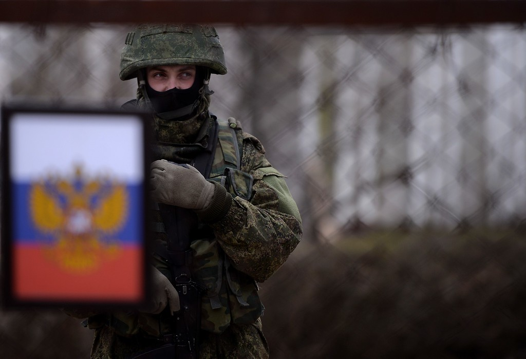. A Russian soldier stands inside the Ukrainian navy south headquarters base in Novoozerne after it was taken over by Russian forces on March 19, 2014.   AFP PHOTO/ Filippo MONTEFORTE/AFP/Getty Images
